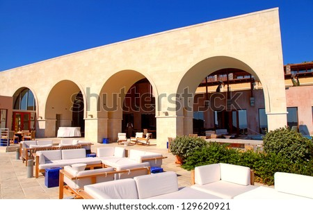 arch terrace with outdoor lounge furniture on summer luxury resort  (Greece) - stock photo