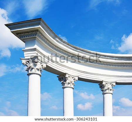 arch with columns on a background sky - stock photo