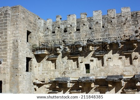 Archaeological ruins of ancient amphitheater in Aspendos, Antalya, Turkey - stock photo