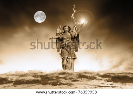 Archangel against moody background - stock photo