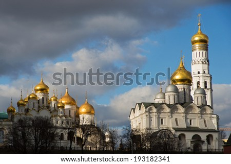 Archangel Cathedral and Ivan the Great Bell in the Moscow Kremlin. Moscow. Russia. Blue sky with clouds background. - stock photo