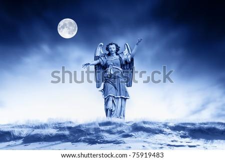 Archangel making religious gestures - stock photo