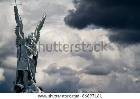 Archangel Michael fights the dragon - stock photo