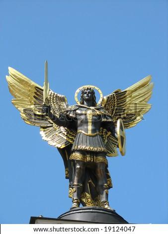 Archangel michael statue from bronze gilded in kiev, ukraine - stock photo