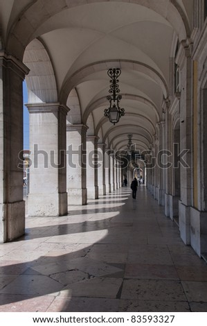 arched doorways on the square trade Lisbon - stock photo