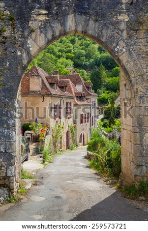 Arched entrance at Saint Circ Lapopie in France - stock photo