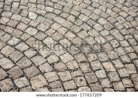 Arched gray cobblestone pavement floor  - stock photo