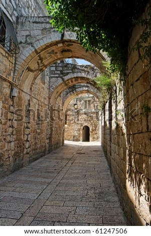 Arched passage in the Old City of Jerusalem - stock photo
