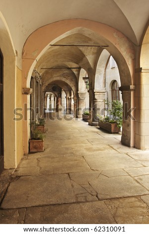 Arched portico in the Piedmontese town of Avigliana - stock photo