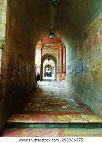 Arched Stone Walkway Outside of Old Church in Ecuador - stock photo