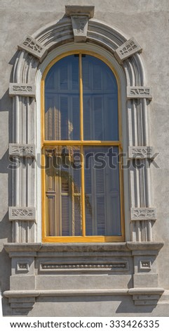 Arched window and gothic trim from the last century in tones of gray/grey and gold, for use as a advertising backdrop.