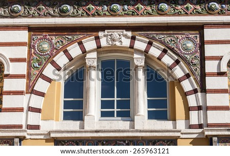 Arched window with colorful ornaments