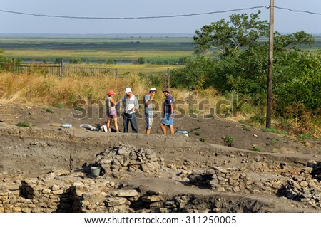 Archeologists on a place of excavation. Settlement of Tanais, Rostov region, Russia. August 24, 2015