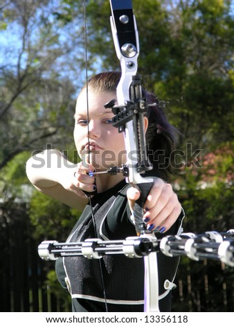 Archer Aiming - stock photo