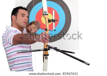 Archer stood in front of target - stock photo