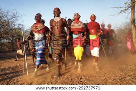 ARCHERS POST - KENYA - JANUARY 14, 2015: Unidentified Samburu dancers attending a wedding ceremony on January 14, 2015 in Archers Post, Kenya.  - stock photo