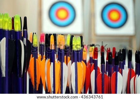 Archery arrows with targets in out of focus background - stock photo