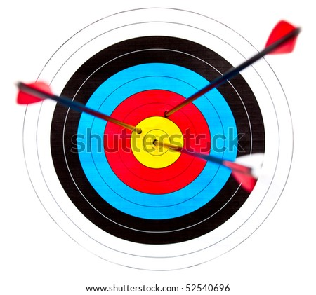 Archery target with arrows in the bullseye - stock photo