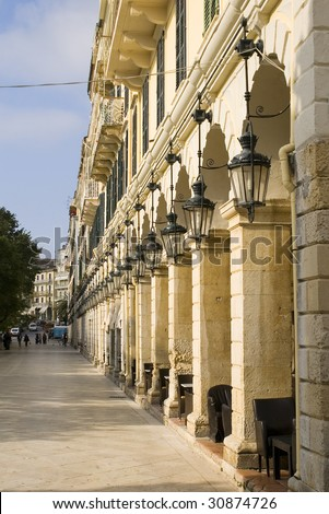Arches and lanterns in line, long building, Corfu, Greece
