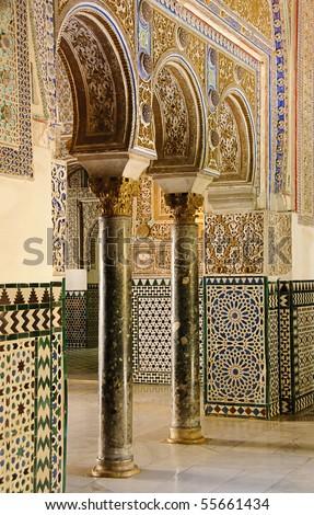 "Arches decorating rooms of the ""Palacio de Don Pedro"" inside the Royal Alcazar in Seville - stock photo"
