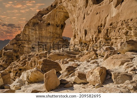 Arches in geological Timna park. The Park, located 25 km north of Eilat, it combines beautiful scenery with special antiquities, history, unique geology and variety of sport and family activities - stock photo