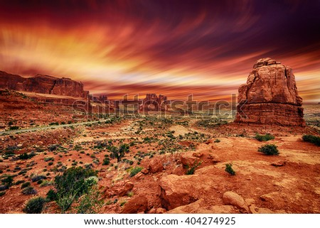 Arches National Park at Sunset. Blurry Sky. Long Exposure. - stock photo