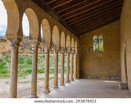 Arches of the portico outside the Mozarabic Church of the Monastery of San Miguel de Escalada Century X in Leon Spain - stock photo