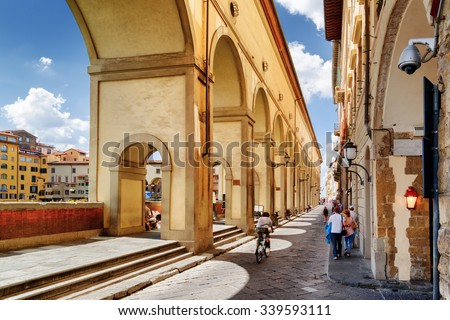 Arches of the Vasari Corridor (Corridoio Vasariano) in Florence, Tuscany, Italy. View of the Lungarno degli Archibusieri. Florence is a popular tourist destination of Europe. - stock photo