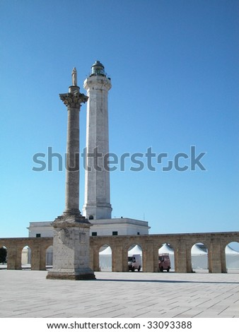 Arches wall and lighthouse located in Santa Maria di Leuca, Apulia, Italy