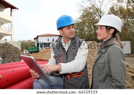 Architect an site supervisor on construction site - stock photo