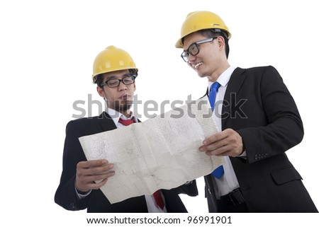 Architect and construction engineer or surveyor discussion plans and blueprints - stock photo