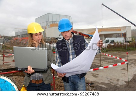 Architect and engineer on construction site - stock photo