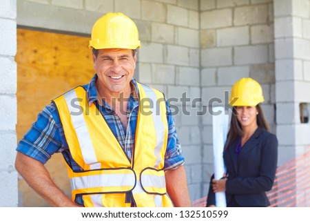 Architect and foreman together at construction site.