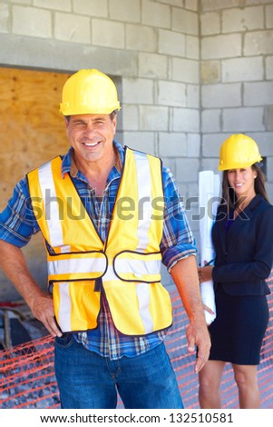 Architect and foreman together at construction site. Vertical Shot - stock photo