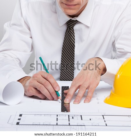 Architect. Architect working with a floorplan