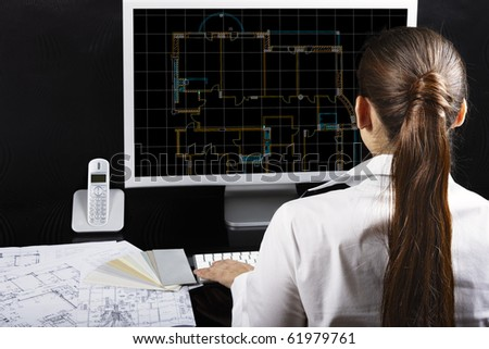 Architect at work. Architectural project on computer monitor. Blueprints on the desk. - stock photo