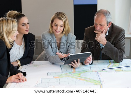 Architect Colleagues Working In Team On Housing Project - stock photo