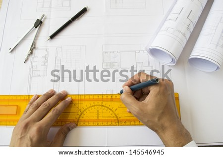 architect designing a plan of a house - stock photo