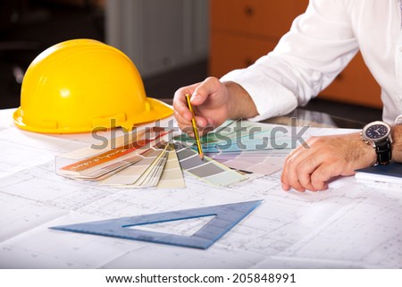 Architect designing house for client - stock photo