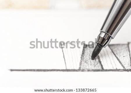 Architect Drawing A Sketch With Pencil - stock photo