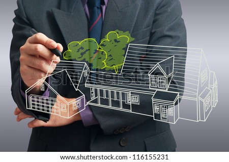 Architect drawing house on screen - stock photo