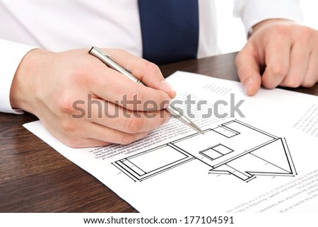 architect draws a drawing house project - stock photo