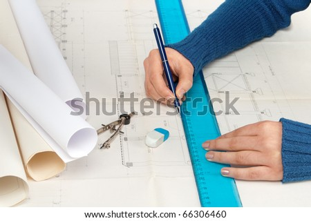 Architect draws a factory building plan - stock photo