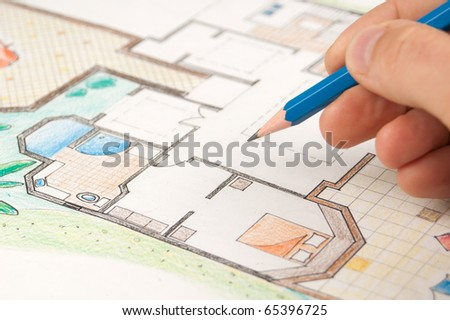 Architect draws a home plan - stock photo