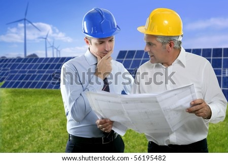 architect engineer two expertise team plan talking hardhat solar plates meadow grass [Photo Illustration] - stock photo