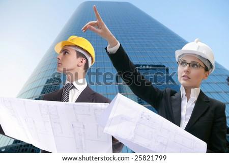 Architect executive business people with plans, hard hat [Photo Illustration] - stock photo