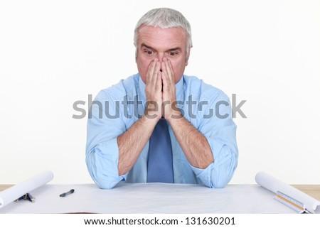 Architect facing a problem - stock photo