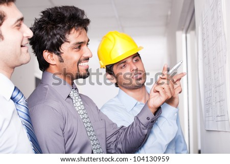 architect giving presentation to a small business group. - stock photo