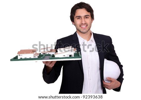 Architect holding a model - stock photo