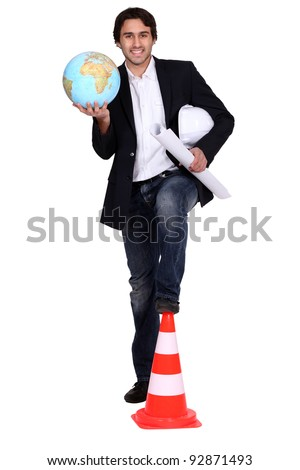 Architect holding globe